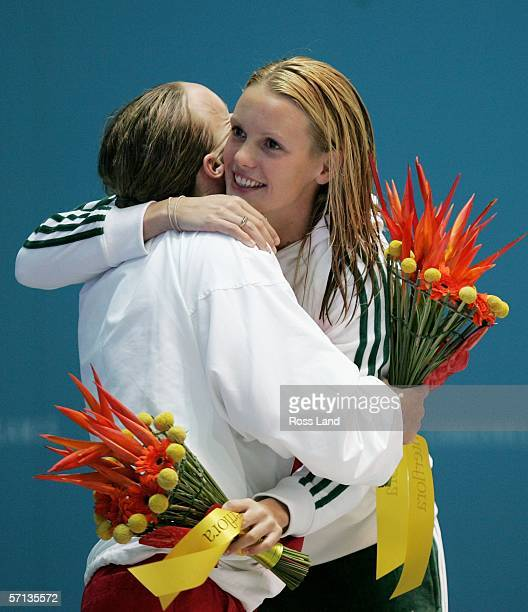 Silver medalist Melanie Marshall of England embraces gold medalist Joanna Fargus of Australia after the women's 50m freestyle final at the swimming...