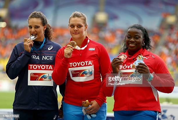 Silver medalist Melina RobertMichon of France gold medalist Sandra Perkovic of Croatia and bronze medalist Yarelys Barrios of Cuba stand on the...