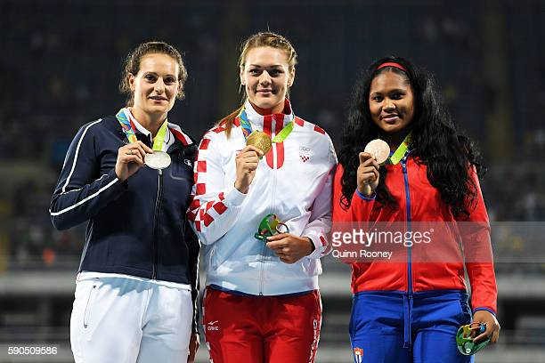 Silver medalist Melina RobertMichon of France gold medalist Sandra Perkovic of Croatia and bronze medalist Denia Caballero of Cuba pose during the...