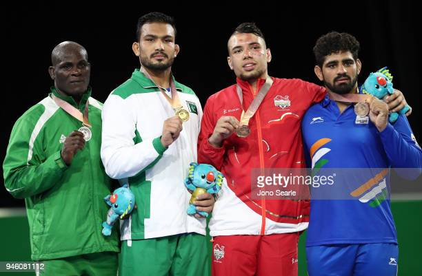 Silver Medalist Melvin Bibo of Nigeria gold medalist Muhammad Inam of Pakistan and duel bronze medalists Eslami Syerus of England and Somveer of...