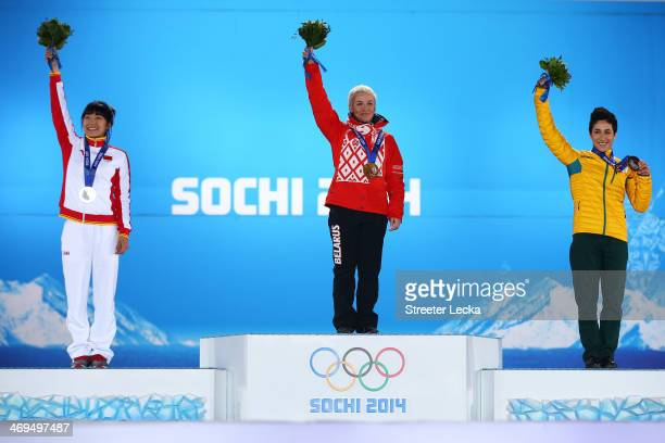 Silver medalist Mengtao Xu of China, gold medalist Alla Tsuper of Beralus and bronze medalist Lydia Lassila of Australia celebrate on the podium...