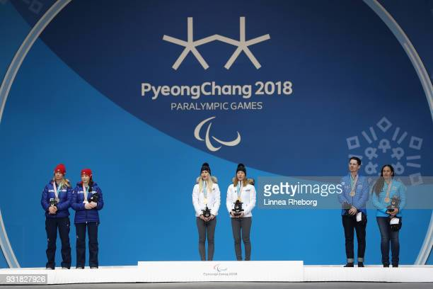 Silver medalist Menna Fitzpatrick of Great Britain and her guide Jennifer Kehoe gold medalist Henrieta Farkasova of Slovakia and her guide Natalia...