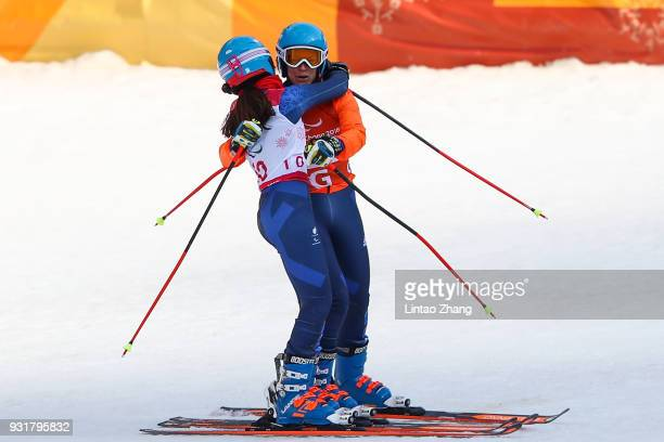 Silver Medalist Menna Fitzpatrick of Great Britain celebrates with her guide Jennifer Kehoe after the Women's Giant Slalom Run 2 Visually Impaired at...