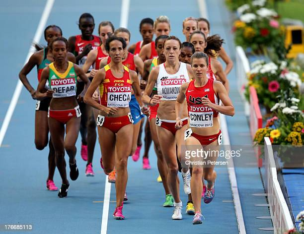 Silver medalist Mercy Cherono of Kenya and Viola Jelagat Kibiwot of Kenya pose after the Women's 5000 metres final during Day Eight of the 14th IAAF...