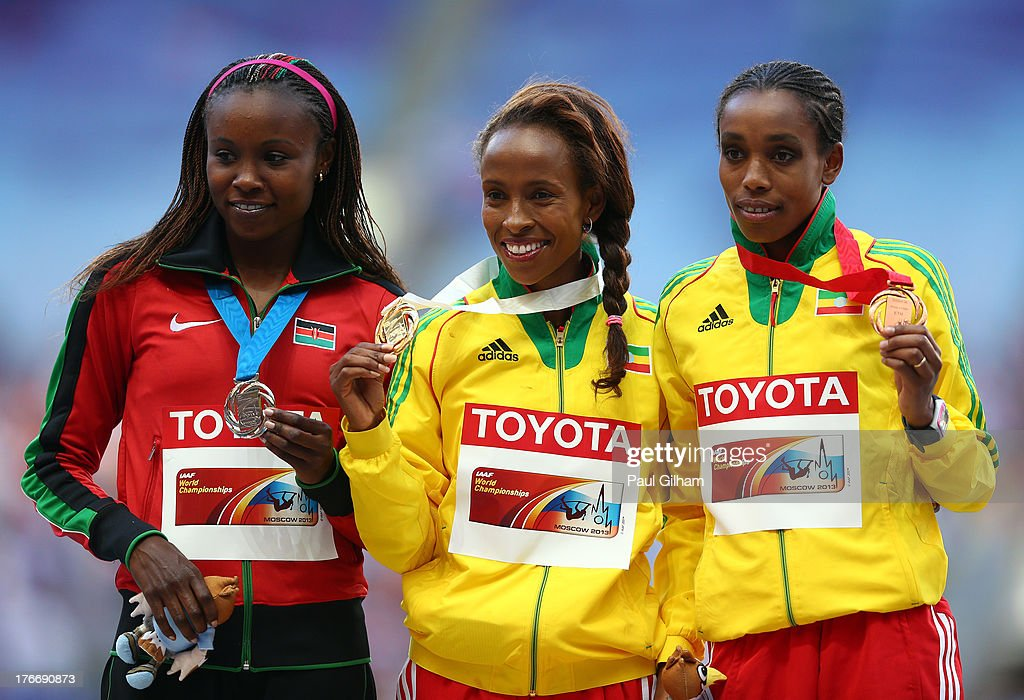 Silver medalist Mercy Cherono of Kenya, gold medalist Meseret Defar of Ethiopia and bronze medalist Almaz Ayana of Ethiopia stand on the podium during the medal ceremony for the Women's 5000 metres during Day Eight of the 14th IAAF World Athletics Championships Moscow 2013 at Luzhniki Stadium on August 17, 2013 in Moscow, Russia.
