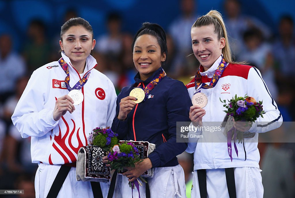 Silver medalist Merve Coban, gold medalist Lucie Ignace of France and Ana Lenard of Croatia pose during the medal ceremony for the Women's Kumite -61kg day one of the Baku 2015 European Games at Crystal Hall on June 13, 2015 in Baku, Azerbaijan.
