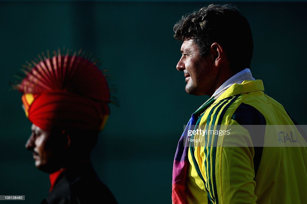 Silver medalist Michael Diamond of Australia (R) attends the medal ceremony following the Men's Singles Trap final at the Dr Karni Singh Shooting Range during day seven of the Delhi 2010 Commonwealth Games on October 10, 2010 in Delhi, India.
