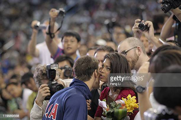 Silver medalist Michael Phelps of the United States is congratulated by girlfriend Nicole Johnson after the Men's 200m Individual Medley Final during...