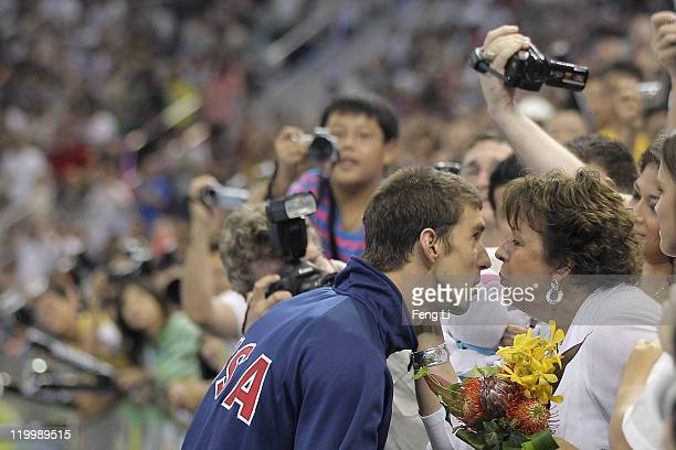 Silver medalist Michael Phelps of the United States is kissed by his mother Debbie after the Men's 200m Individual Medley Final during Day Thirteen...