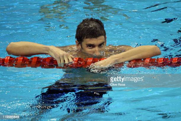 Silver medalist Michael Phelps of the United States looks dejected after the Men's 200m Individual Medley Final during Day Thirteen of the 14th FINA...