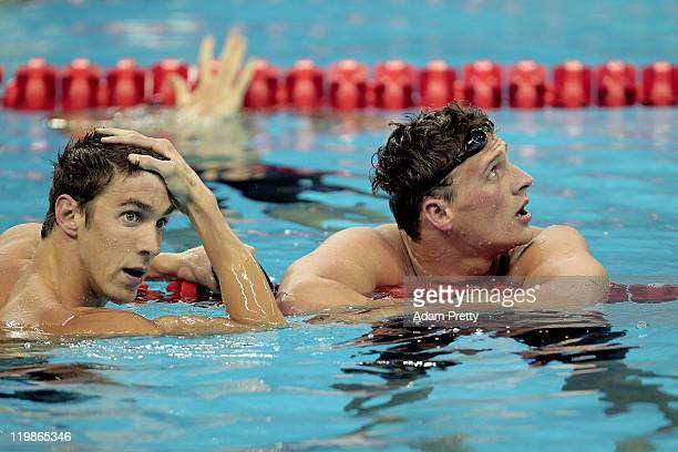 Silver medalist Michael Phelps of United States looks on with gold medalist Ryan Lochte after the Men's 200m Freestyle Final during Day Eleven of the...