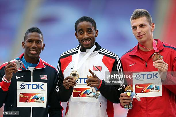 Silver medalist Michael Tinsley of the United States gold medalist Jehue Gordon of Trinidad and Tobago and bronze medalist Emir Bekric of Serbia pose...