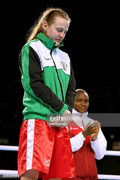 Silver medalist Michaela Walsh of Northern Ireland looks dejected as Gold medalist Nicola Adams of England looks on during the medal ceremony for the...