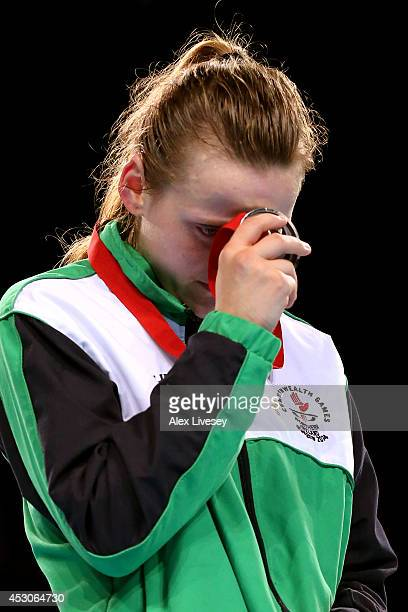 Silver medalist Michaela Walsh of Northern Ireland reacts during the medal ceremony for the Women's Fly Final at SSE Hydro during day ten of the...