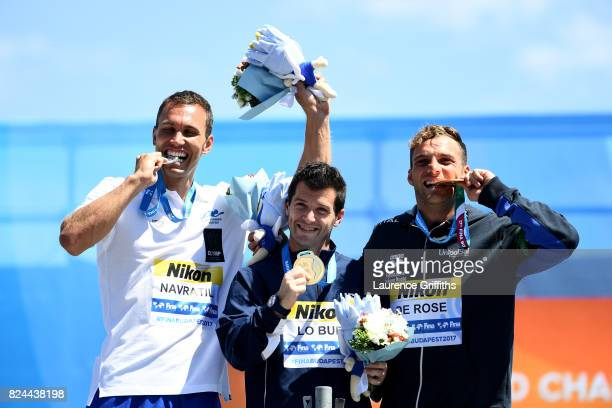 Silver medalist Michal Navratil of the Czech Republic gold medalist Steve Lo Bue of the United States and bronze medalist Allesandro De Rose of Italy...