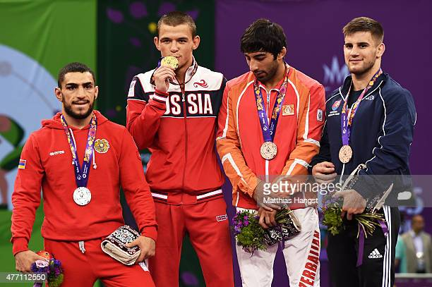Silver Medalist Migran Arutyunyan of Armenia Gold Medalist Artem Surkov of Russian Bronze Medalist Hasan Aliyev of Azerbaijan and Bronze Medalist...