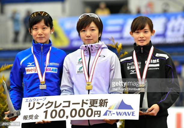 Silver medalist Miho Takagi gold medalist Nao Kodaira and bronze medalist Arisa Go pose on the podium at the medal ceremony for the Ladies 1000m...