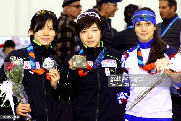 Silver medalist Miho Takagi of Japan gold medalist Nao Kodaira of Japan and bronze medalist Yekaterina Shikhova of Russia pose on the podium at the...