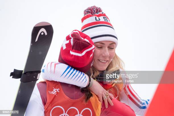 Silver medalist Mikaela Shiffrin of the United States and bronze medalist Wendy Holdener from Switzerland hug as the result is confirmed during the...