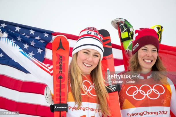 Silver medalist Mikaela Shiffrin of the United States and gold medal winner Michelle Gisin from Switzerland on the podium during the Alpine Skiing...