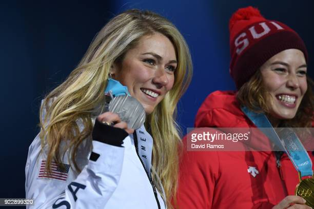 Silver medalist Mikaela Shiffrin of the United States and gold medalist Michelle Gisin of Switzerland celebrate during the medal ceremony for Alpine...