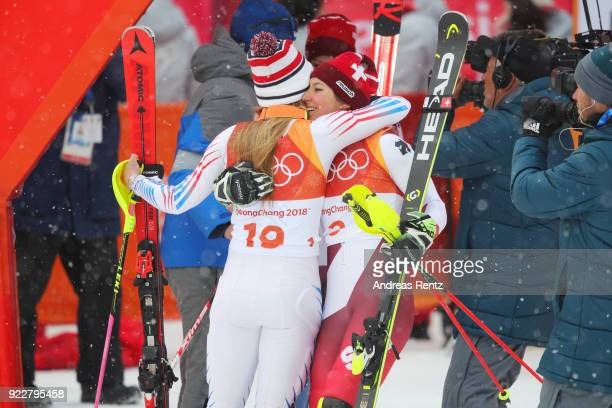 Silver medalist Mikaela Shiffrin of the United States celebrates with bronze medalist Wendy Holdener of Switzerland during the Ladies' Alpine...