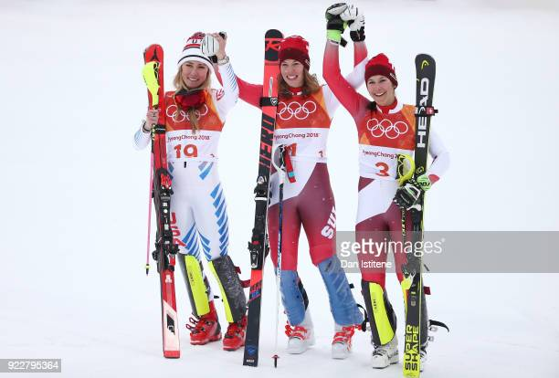 Silver medalist Mikaela Shiffrin of the United States gold medalist Michelle Gisin of Switzerland and bronze medalist Wendy Holdener of Switzerland...