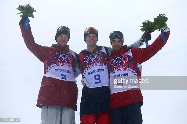 Silver medalist Mike Riddle of Canada gold medalist David Wise of the United States and bronze medalist Kevin Rolland of France celebrate during the...