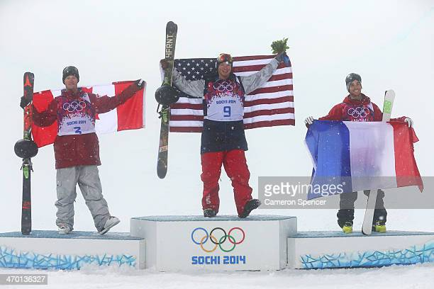 Silver medalist Mike Riddle of Canada, gold medalist David Wise of the United States and bronze medalist Kevin Rolland of France celebrate during the...