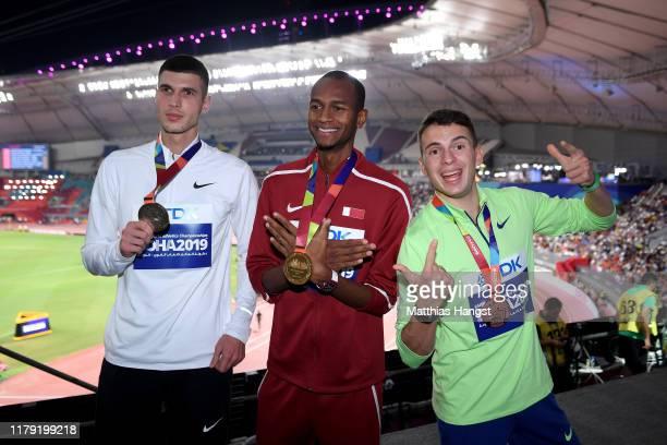 Silver medalist Mikhail Akimenko of Authorised Neutral Athletes, gold medalist Mutaz Essa Barshim of Qatar and bronze medalist Ilya Ivanyuk of...