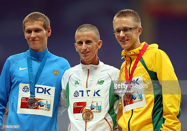 Silver medalist Mikhail Ryzhov of Russia gold medalist Robert Heffernan of Ireland and bronze medalist Jared Tallent of Australia stand on the podium...