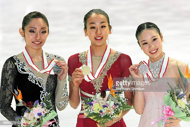 Silver medalist Miki Ando gold medalist Mao Asada and bronze medalist Yukari Nakano pose on the podium at the medal ceremony for the Ladies' Singles...