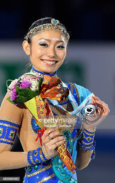 Silver medalist Miki Ando poses for photographs on the podium at the medal ceremony for the Ladies Singles during day three of the ISU Figure Skating...