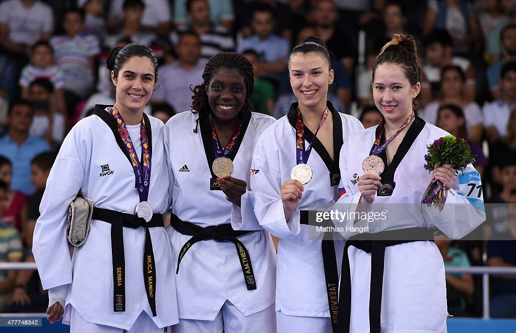 Silver medalist Milica Mandic of Serbia, gold medalist Gwladys Epangue of France and bronze medalists Iva Rados of Croatia and Olga Ivanova of Russia stand on the podium during the medal ceremony for the Women's +67kg Taekwondo on day seven of the Baku 2015 European Games at the Crystal Hall on June 19, 2015 in Baku, Azerbaijan.