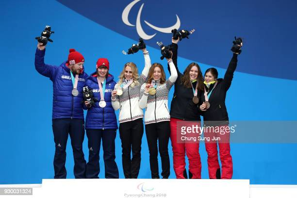Silver medalist Millie Knight of Great Britain Gold medalist Henrieta Farkasova of Slovakia and bronze medalist Eleonor Sana of Belgium pose for the...