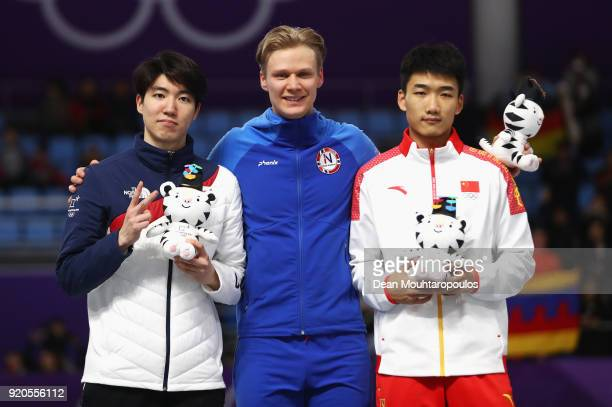 Silver medalist Min Kyu Cha of Korea gold medalist Havard Lorentzen of Norway and bronze medalist Tingyu Gao of China stand on the podium during the...