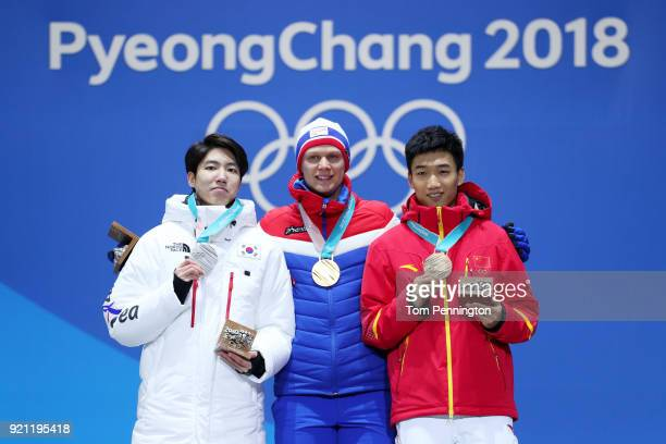 Silver medalist Min Kyu Cha of Korea gold medalist Havard Lorentzen of Norway and bronze medalist Tingyu Gao of China celebrate during the medal...