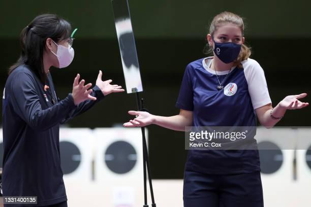 Silver Medalist Minjung Kim of Team South Korea and Gold Medalist Vitalina Batsarashkina of Team ROC following the 25m Pistol Women's Finals on day...