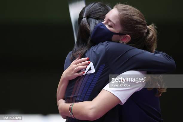 Silver Medalist Minjung Kim of Team South Korea hugs Gold Medalist Vitalina Batsarashkina of Team ROC following the 25m Pistol Women's Finals on day...