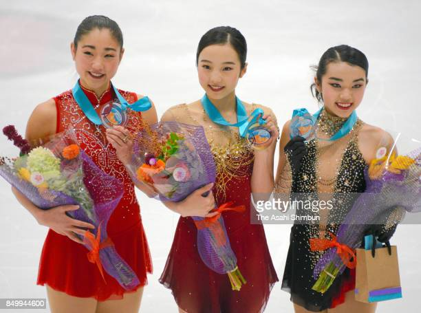 Silver medalist Mirai Nagasu of the United States gold medalist Marin Honda of Japan and bronze medalist Karen Chen of the United States pose for...