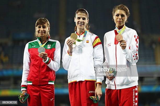 Silver medalist Mirela Demireva of Bulgaria gold medalist Ruth Beitia of Spain and bronze medalist Blanka Vlasic of Croatia stand on the podium...