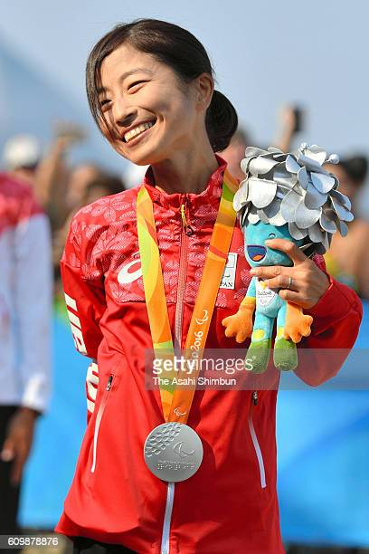 Silver medalist Misato Michishita of Japan celebrates on the podium at the medal ceremony for the Women's Marathon T12 at Fort Copacabana on day 11...