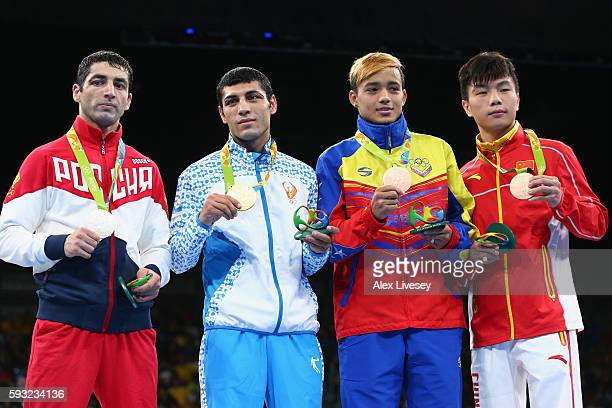 Silver medalist Misha Aloian of Russia gold medalist Shakhobidin Zoirov of Uzbekistan and bronze medalists Yoel Segundo Finol of Venezuela and...