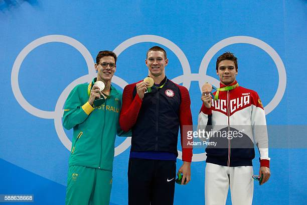 Silver medalist Mitch Larkin of Australia gold medalist Ryan Murphy of the United States and bronze medalist Evgeny Rylov of Russia celebrate on the...