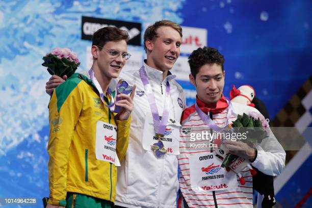 Silver medalist Mitchell Larkin of Australia gold medalist Chase Kalisz of the United States and bronze medalist Kosuke Hagino of Japan pose for...