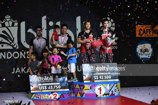 Silver medalist Mohammad Ahsan and Hendra Setiawan of Indonesia and gold medalist Marcus Fernaldi Gideon and Kevin Sanjaya Sukamuljo of Indonesia...