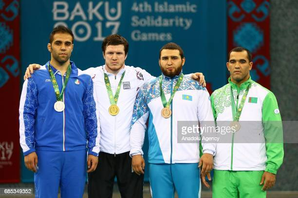 Silver medalist Mohammadi Amir of Iran gold medalist Gadzihiyev Nurmagomed of Iran bronze medalists Ibragimov Mamed of Kazakhstan and Melejayev Yusup...