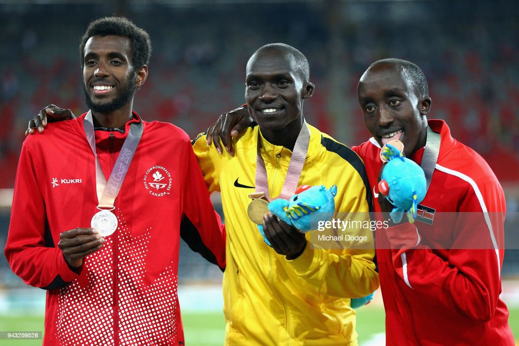 Silver medalist Mohammed Ahmed of Canada, gold medalist Joshua Kiprui Cheptegei of Uganda and bronze medalist Edward Pingua Zakayo of Kenya pose during the medal ceremony for the Men's 5000m Final on day four of the Gold Coast 2018 Commonwealth Games at Carrara Stadium on April 8, 2018 on the Gold Coast, Australia.