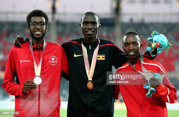 Silver medalist Mohammed Ahmed of Canada gold medalist Joshua Kiprui Cheptegei of Uganda and bronze medalist Rodgers Kwemoi of Kenya pose during the...