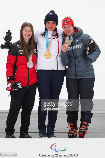 silver medalist Mollie Jepsen of Canada gold medalist Marie Bouchet of France and bronze medalist Andrea Rothfuss of Germany celebrate during the...